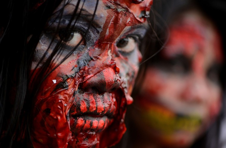 Students dressed as zombies participate in an annual Halloween Costume Parade in Manila. The activity aims to celebrate Halloween in a creative and fun way through the showcase of scary costumes. (Noel Celis/Getty Images)