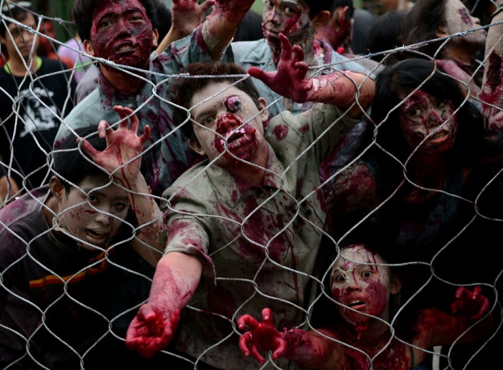 Students dressed as zombies participate in an annual Halloween Costume Parade in Manila. (Noel Celis/Getty Images)