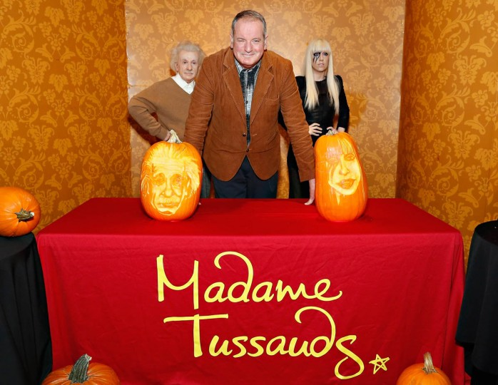 Pumpkin carver Hugh McCahon poses with carved pumpkins featuring the likeness of scientist Albert Einstein and singer Lady Gaga as Madame Tussauds New York kicks off a special Halloween weekend featuring a live pumpkin carving performance on October 22, 2013 in New York City. (Cindy Ord/Getty Images)
