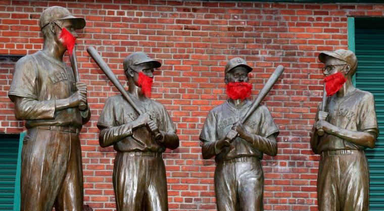 Statues are seen outside Fenway Park before Game One of the World Series between the Boston Red Sox and the St. Louis Cardinals on October 23, 2013 in Boston, Massachusetts. (Jamie Squire/Getty Images)