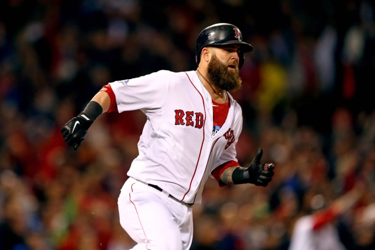 Mike Napoli #12 of the Boston Red Sox rounds the bases after hitting a three run double in the first inning against the St. Louis Cardinals during Game One of the 2013 World Series at Fenway Park on October 23, 2013 in Boston, Massachusetts. (Elsa/Getty Images)
