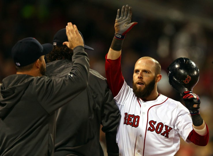Dustin Pedroia #15 of the Boston Red Sox returns to the dugout after scoring in the first inning against the St. Louis Cardinals during Game One of the 2013 World Series at Fenway Park on October 23, 2013 in Boston, Massachusetts. (Elsa/Getty Images)