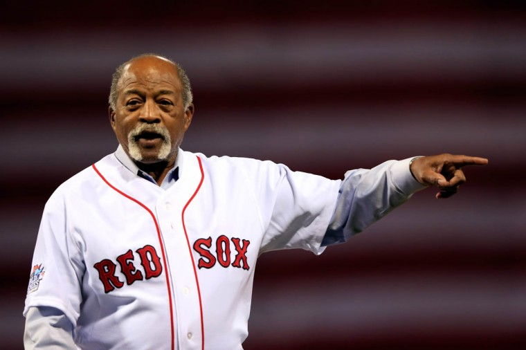 Former Boston Red Sox player Luis Tiant waves to the crowd before Game One of the 2013 World Series between the Boston Red Sox and the St. Louis Cardinals at Fenway Park on October 23, 2013 in Boston, Massachusetts. (Jamie Squire/Getty Images)
