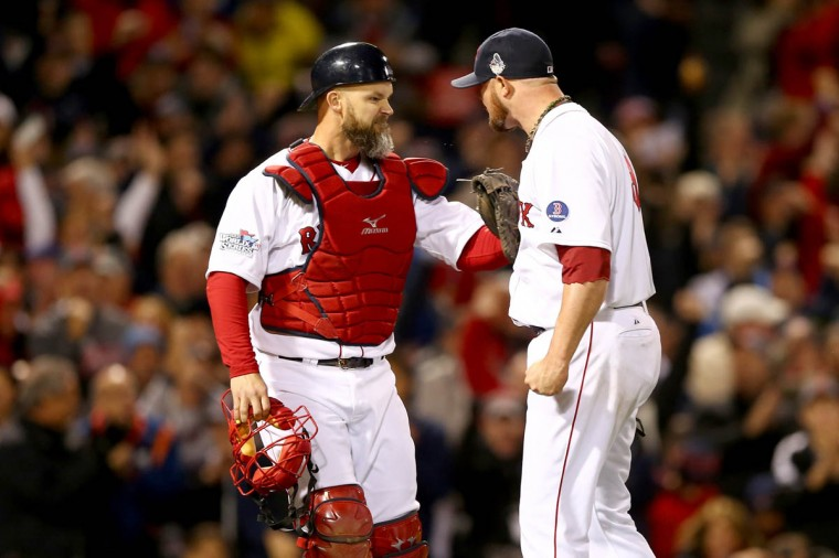 Jon Lester #31 of the Boston Red Sox celebrates with David Ross #3 at the end of the fourth inning against the St. Louis Cardinals during Game One of the 2013 World Series at Fenway Park on October 23, 2013 in Boston, Massachusetts. (Elsa/Getty Images)