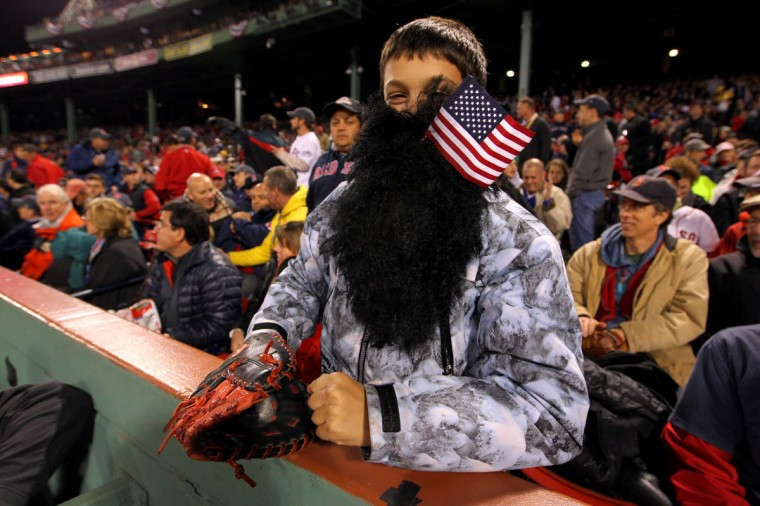 A fan poses for a photo during Game One of the 2013 World Series between the Boston Red Sox and the St. Louis Cardinals at Fenway Park on October 23, 2013 in Boston, Massachusetts. (Jamie Squire/Getty Images)