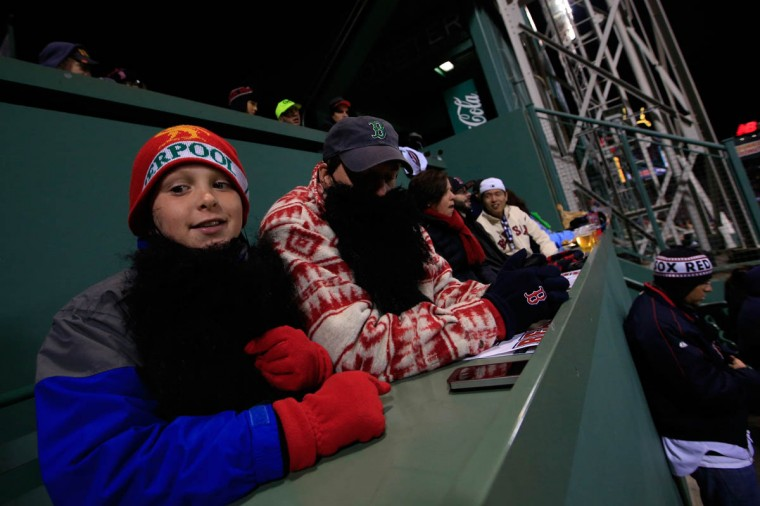 Fans watch from the Green Monster during Game Two of the 2013 World Series between the Boston Red Sox and the St. Louis Cardinals at Fenway Park on October 24, 2013 in Boston, Massachusetts. (Jamie Squire/Getty Images)