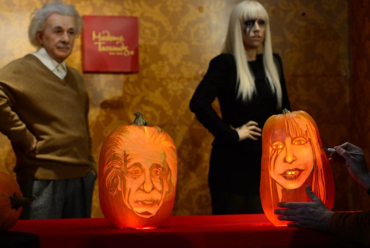 Pumpkins representing US singer Lady Gaga (Right) and scientist Albert Einstein are on display in front of their wax figures at Madame Tussauds ahead of Halloween in New York on October 22, 2013. (Emmanuel Dunand/Getty Images)