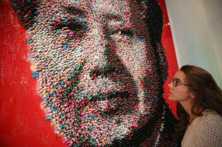 A woman admires an artwork by Joe Black of Mao Zedong entitled, 'Workers of the World, Unite!', which is made from 9000 hand-painted toy soldiers, in the Opera Gallery on October 14, 2013 in London, England. The Opera gallery is hosting contemporary artist Joe Black's first solo exhibition entitled 'Ways of Seeing', which opens to the public on October 18, 2013. (Oli Scarff/Getty Images)
