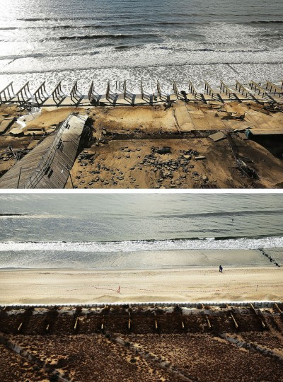 (top) The foundations to the historic Rockaway boardwalk are all that remain after it was washed away during Hurricane Sandy on October 31, 2012 in the Rockaway neighborhood of the Queens borough of New York City. (bottom) Two people stand on the beach on October 20, 2013 in the Rockaway neighborhood of the Queens borough of New York City. Hurricane Sandy made landfall on October 29, 2012 near Brigantine, New Jersey and affected 24 states from Florida to Maine and cost the country an estimated $65 billion. (Spencer Platt/Getty Images)