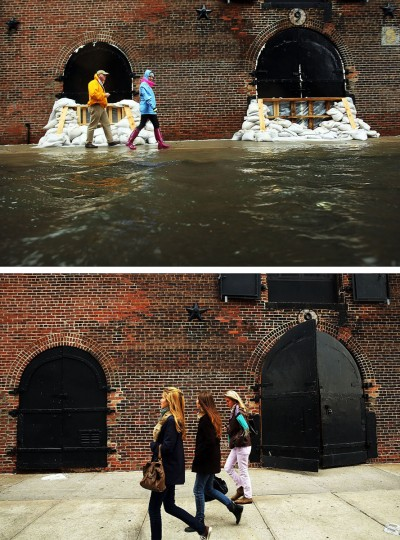 NEW YORK, NY - OCTOBER 29: (top) People walk past sandbags on a flooded street as Hurricane Sandy moves closer to the area on October 29, 2012 in the Red Hook section of the Brooklyn borough of New York City. NEW YORK, NY - OCTOBER 23: (bottom) People walk past a building on October 23, 2013 in the Red Hook section of the Brooklyn borough of New York City. Hurricane Sandy made landfall on October 29, 2012 near Brigantine, New Jersey and affected 24 states from Florida to Maine and cost the country an estimated $65 billion. (Spencer Platt/Getty Images)