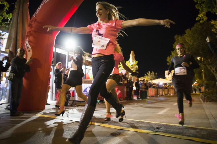 JERUSALEM, ISRAEL - OCTOBER 24: (ISRAEL OUT) Israeli women race in high heels in support of breast cancer awareness on October 24, 2013 in Jerusalem, Israel. The race was organized for breast cancer awareness by the Saucony company and the Israeli Cancer Assosiation. (Uriel Sinai/Getty Images)