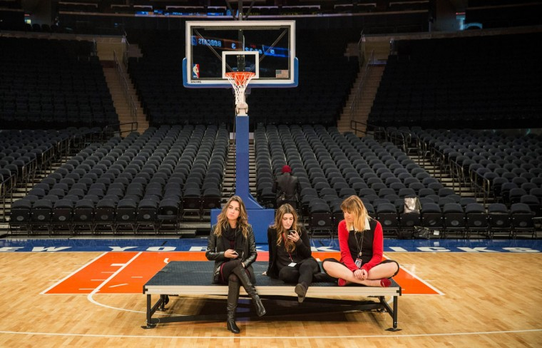 NEW YORK, NY - OCTOBER 24: Women sit on a riser during a tour announcing the completion of three-year, $1 Billion dollar face lift to Madison Square Garden on October 24, 2013 in New York City. Madison Square Garden is home to the basketball team the New York Knicks and the hockey team the New York Rangers, and also hosts events ranging from live music shows, political events and professional boxing matches. The Garden also faces new challenges in the live entertainment business from the recently opened Barclay's Center in Brooklyn, NY. (Andrew Burton/Getty Images)