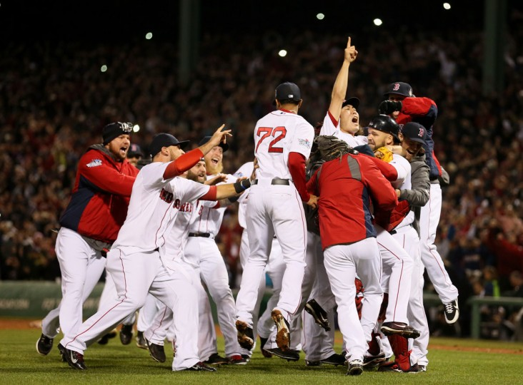 The Boston Red Sox celebrate after defeating the St. Louis Cardinals in Game Six of the 2013 World Series at Fenway Park. (Rob Carr/Getty Images)