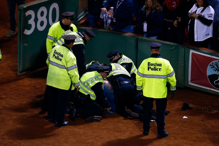 Police subdue a fan following Game Six of the 2013 World Series at Fenway Park. (Jared Wickerham/Getty Images)