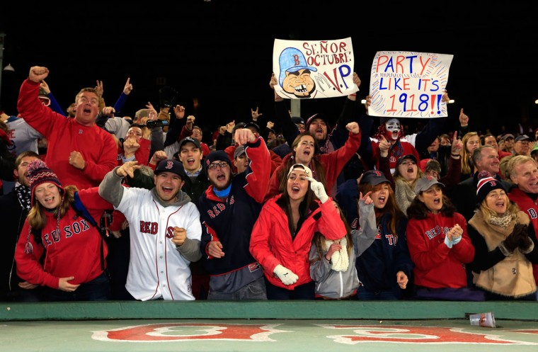 Fans react after the Boston Red Sox defeated the St. Louis Cardinals 6-1 in Game Six of the 2013 World Series at Fenway Park. (Jamie Squire/Getty Images)