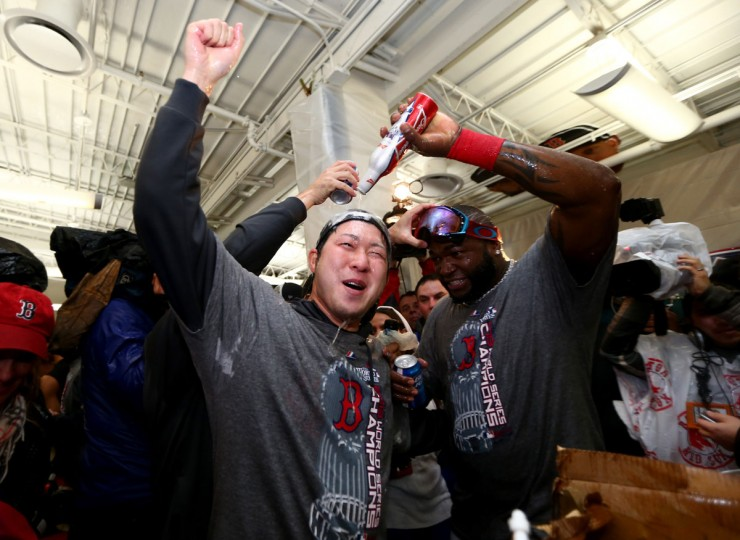 Junichi Tazawa and David Ortiz of the Boston Red Sox celebrate in the locker room following a 6-1 victory over the St. Louis Cardinals in Game Six of the 2013 World Series at Fenway Park. (Elsa/Getty Images)