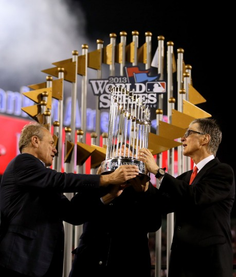 John Henry, owner of the Boston Red Sox, is presented with the trophy after the Boston Red Sox defeated the St. Louis Cardinals 6-1 in Game Six of the 2013 World Series at Fenway Park. (Rob Carr/Getty Images)