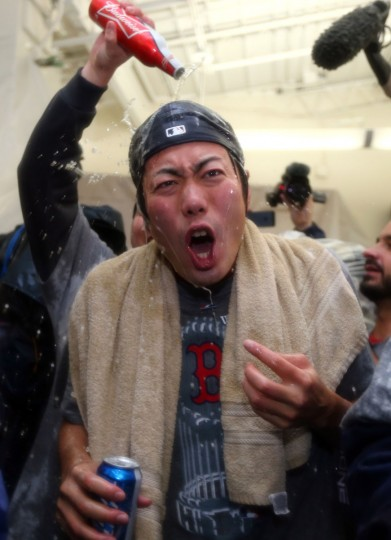 Koji Uehara of the Boston Red Sox celebrates in the locker room after defeating the St. Louis Cardinals 6-1 in Game Six of the 2013 World Series at Fenway Park. (Elsa/Getty Images)