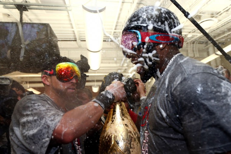 Jacoby Ellsbury and David Ortiz of the Boston Red Sox celebrate in the locker room after defeating the St. Louis Cardinals 6-1 in Game Six of the 2013 World Series at Fenway Park. (Elsa/Getty Images)