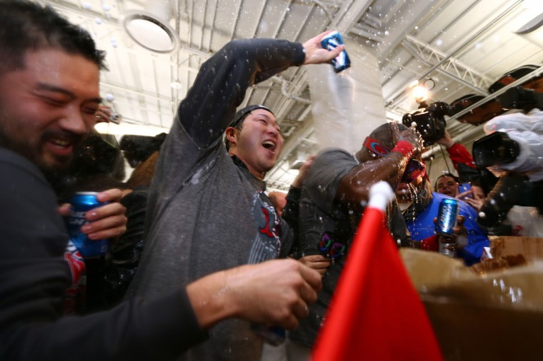 Junichi Tazawa of the Boston Red Sox celebrates in the locker room after defeating the St. Louis Cardinals 6-1 in Game Six of the 2013 World Series at Fenway Park. (Elsa/Getty Images)