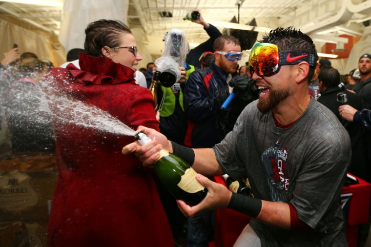 Jacoby Ellsbury of the Boston Red Sox celebrates in the locker room after defeating the St. Louis Cardinals 6-1 in Game Six of the 2013 World Series at Fenway Park. (Elsa/Getty Images)