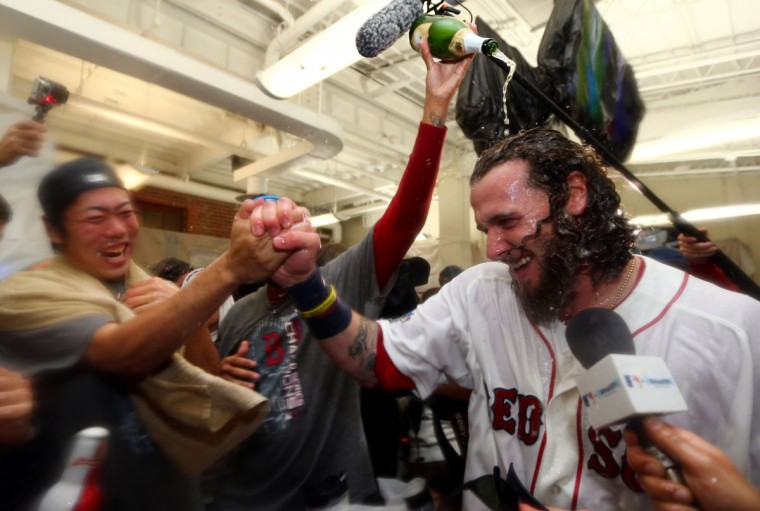 Koji Uehara and Jarrod Saltalamacchia of the Boston Red Sox celebrate in the locker room after defeating the St. Louis Cardinals 6-1 in Game Six of the 2013 World Series at Fenway Park. (Elsa/Getty Images)