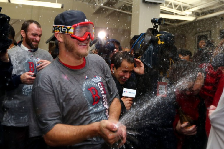 Jake Peavy of the Boston Red Sox celebrates in the locker room after defeating the St. Louis Cardinals 6-1 in Game Six of the 2013 World Series at Fenway Park. (Elsa/Getty Images)