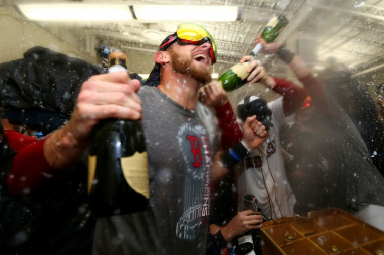 Will Middlebrooks of the Boston Red Sox celebrates in the locker room after defeating the St. Louis Cardinals 6-1 in Game Six of the 2013 World Series at Fenway Park. (Elsa/Getty Images)
