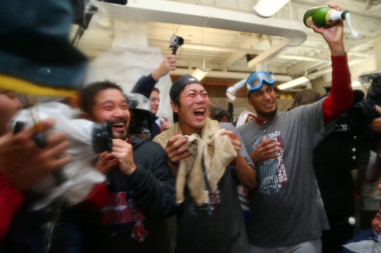 Koji Uehara and Felix Doubront of the Boston Red Sox celebrate in the locker room after defeating the St. Louis Cardinals 6-1 in Game Six of the 2013 World Series at Fenway Park. (Elsa/Getty Images)