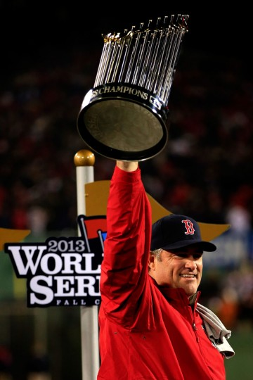 Manager John Farrell holds up the World Series trophy after the Boston Red Sox defeated the St. Louis Cardinals in Game Six of the 2013 World Series. (Jamie Squire/Getty Images)