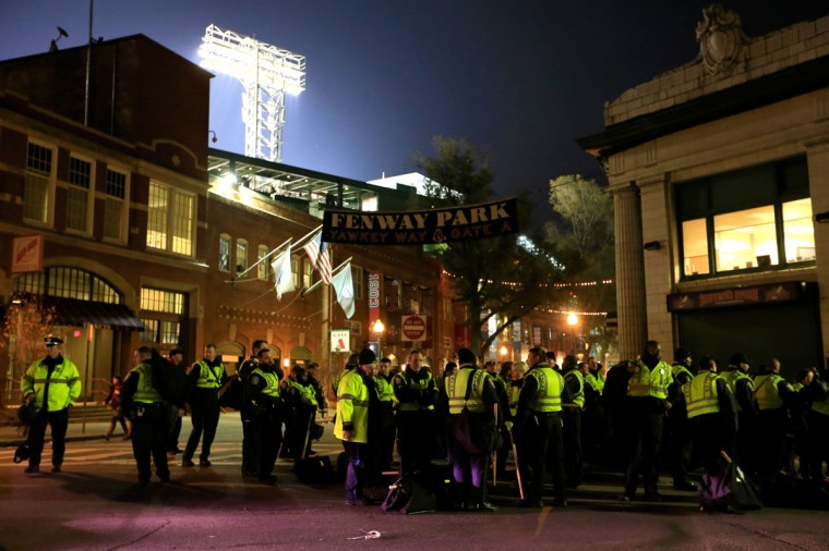 Boston Police officers stand outside Fenway Park following a 6-1 victory for the Boston Red Sox over the St. Louis Cardinals in Game Six of the 2013 World Series. (Jamie Squire/Getty Images)