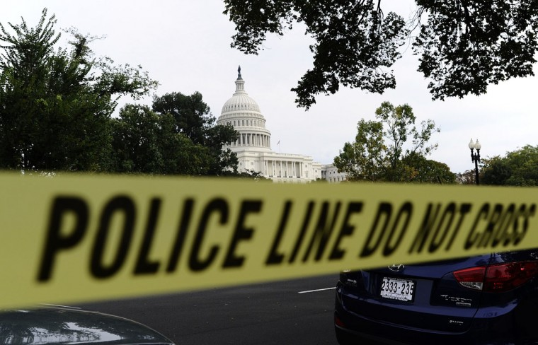 Police cordon off the U.S. Capitol after a dramatic car chase through the streets of Washington. (JEWEL SAMAD / AFP/Getty Images)