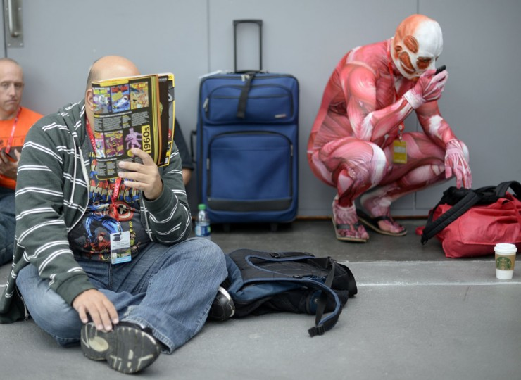 Fans in costume arrive for the opening session of the 2013 New York Comic Con at the Jacob Javits Center. (TIMOTHY CLARY / AFP/Getty Images)