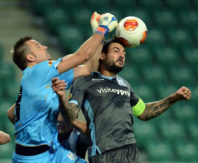 Apollon Limassol's goalkeeper Isli Hidi and Georgos Merkis vie for a ball during UEFA Europa League football match with Legia Warszawa vs. Apollon Limassol FC in Warsaw. (JANEK SKARZYNSKI / AFP/Getty Images)