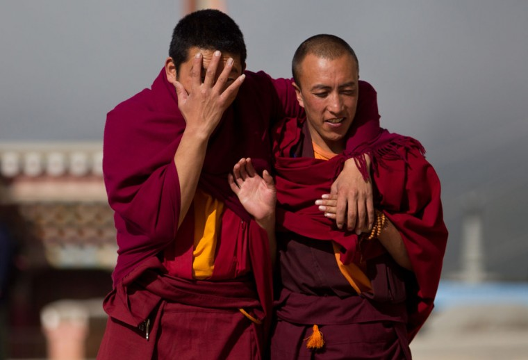 Tibetan monks share a light moment at the Ganden Sumtsenling Monastery in Shangri-La, Diqing Tibetan Autonomous Prefecture of southwest China's Yunnan Province. (DALE de la REY / AFP/Getty Images)