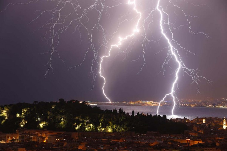 "Flashes of lightning strike above the ""Baie des Anges"", on October 4, 2013, in Nice, southeastern France. (Valery Hache/AFP)"