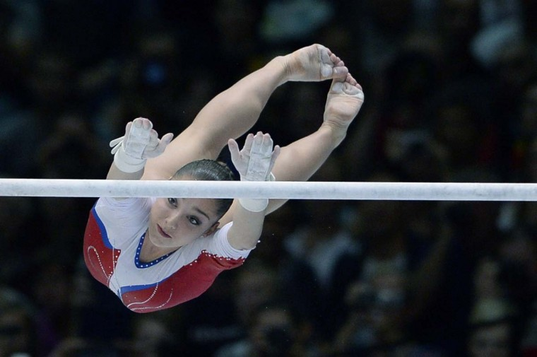 Russia's gymnast Aliya Mustafina competes in the uneven bars event of the Apparatus Final at the 44th Artistic Gymnastics World Championships in Antwerp on October 5, 2013. (Martin Bureau/AFP)