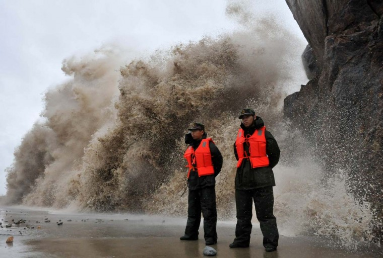 A huge wave hits the dike as Typhoon Fitow moves to make its landfall in Wenling, east China's Zhejiang province on October 6, 2013. China was on its highest alert for Typhoon Fitow on October 6, with tens of thousands evacuated as the storm was set to slam into the east coast. (AFP)