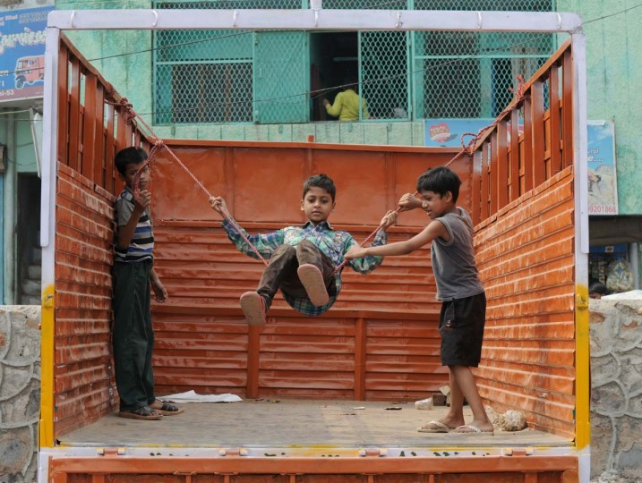 Indian children play on a swing strung up on the back of a truck in New Delhi on October 6, 2013. Play is essential to optimal child development and has been recognized by the United Nations High Commission for Human Rights as a right of every child. (Sajjad Hussain/ AFP)