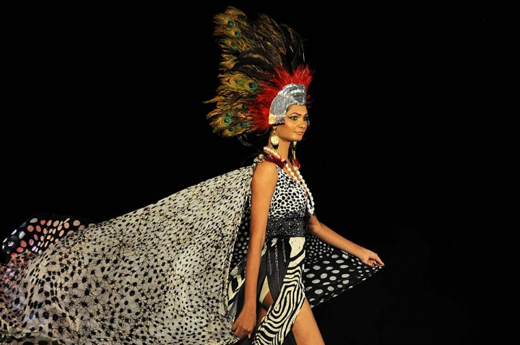 A model displays a creation by fashion designer Sonali at the annual HSBC Resort fashion week in Galle on October 6, 2013. Designers from Sri Lanka, India, Pakistan and Bangladesh were among the dozens of fashion designers who displayed their work at the 2-day event that began on October 5. (Ishara S. Kodikara/AFP)