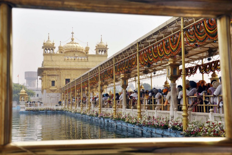 Sikh devotees gather to pay their respects at the Sikh Shrine The Golden Temple in Amritsar, India on October 8, 2013, on the eve of the birth anniversary of the fourth Sikh Guru Ramdass. Ramdass was born in Lahore in 1574 and is Chauthi Patshahi or the fourth Guru as well as the Guru who established the city of Amritsar. (Narinder Nanu/AFP/Getty Images)