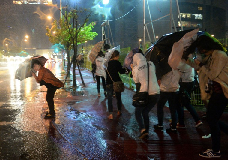 Residents brave strong winds and heavy rain brought about by Typhoon Danas in Busan, South Korea, on October 8, 2013. Packing winds of up to 112 miles per hour near its center, Danas was churning northwest towards the southern Okinawa island chain and was expected to reach a point off the western coast of Kyushu island by early on October 9. (Ted Aljibe/AFP/Getty Images)