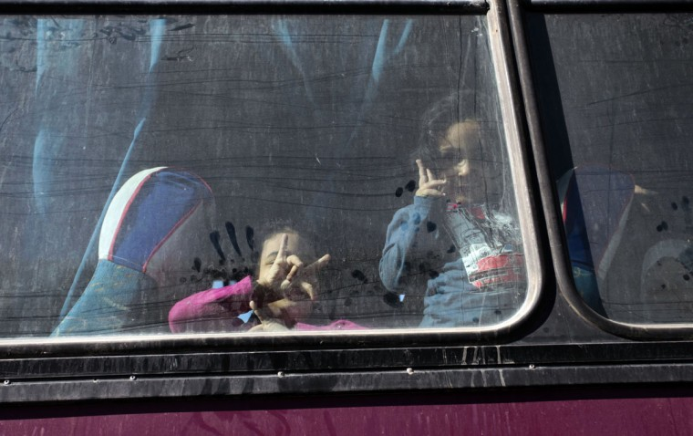 Palestinians sit in a coach as they wait to cross into Egypt at the Rafah crossing terminal in the southern Gaza Strip on the border with Egypt on October 8, 2013. Hundreds of patients, students and foreign residents from the Palestinian side have rushed to the Rafah crossing after the Egyptian announcement of re-opening it for 5 days. (Said Khatib/AFP/Getty Images)
