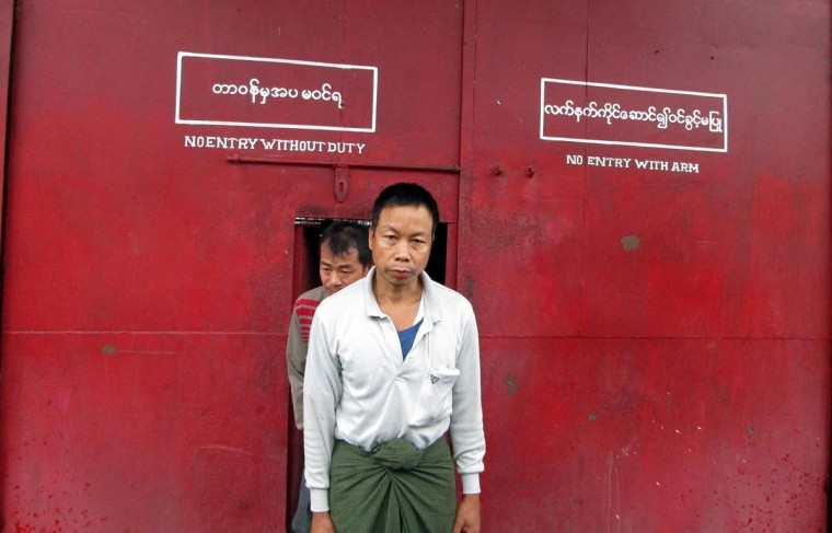 A political prisoner walks out of a prison after his release in Kalay, in Myanmar's northern Sagaing division on October 8, 2013. Myanmar on October 8 began freeing dozens of its remaining detained activists, officials said, after the country vowed to release all prisoners of conscience by the end of the year. (STR/AFP/Getty Images)