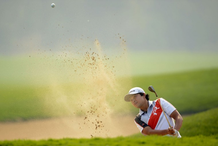 Lee Hoon-heui of South Korea hits a shot during the first round of the Nanshan China Masters at the Montgomerie Course, Nanshan International Golf Club, in Shandong Province, China. (OneAsia / Paul Lakatos /AFP/Getty Images)