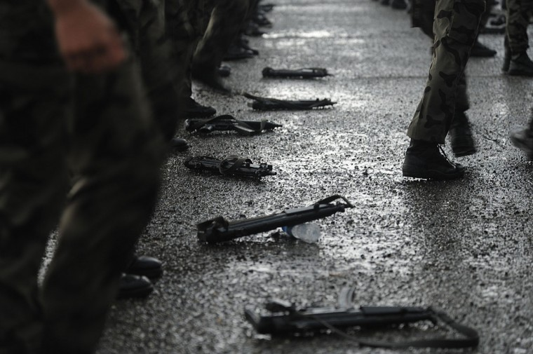 Weapons are seen lying on the ground as members of the Saudi special police unit perform during a parade in Mecca. (FAYEZ NURELDINE / AFP/Getty Images)
