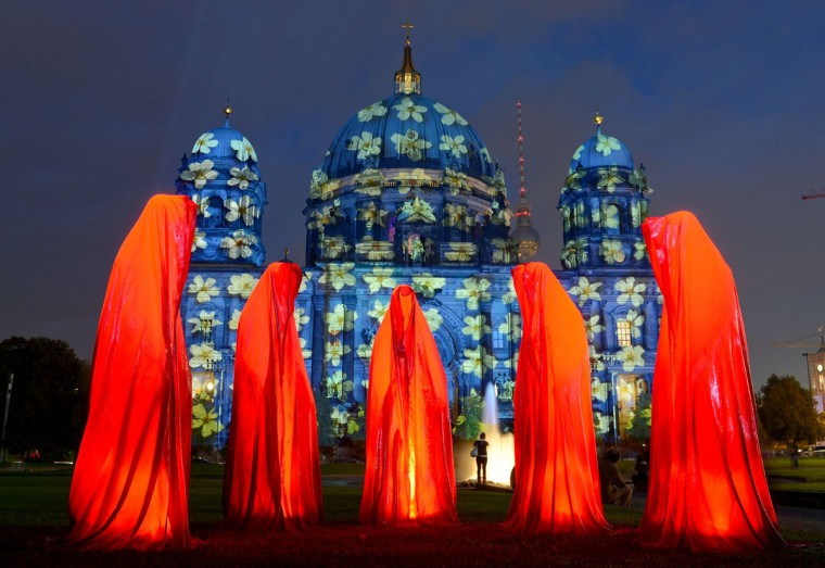 "The installation ""Keeper of Time"" is seen in front of enlightened Berlin Cathedral Wednesday on the first day of Festival of Lights. (BRITTA PEDERSEN/AFP/Getty Images)"