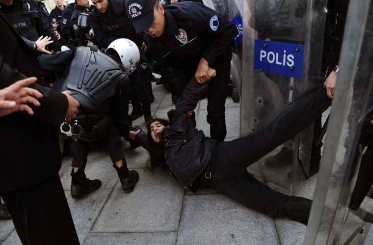 Leftist protestors clash with riot policemen in front of Istanbul courthouse as they try to attend their student friends' trial who have been in jail for months. (BULENT KILIC / AFP/Getty Images)