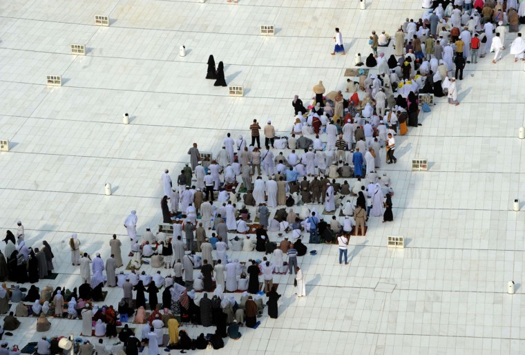 Muslim pilgrims gather under the shade as they arrive to perform the afternoon prayer in Mecca's Grand Mosque as more than 2 million Muslims arrived in Saudi Arabia for the hajj pilgrimage to the shrine city. (FAYEZ NURELDINE / AFP/Getty Images)