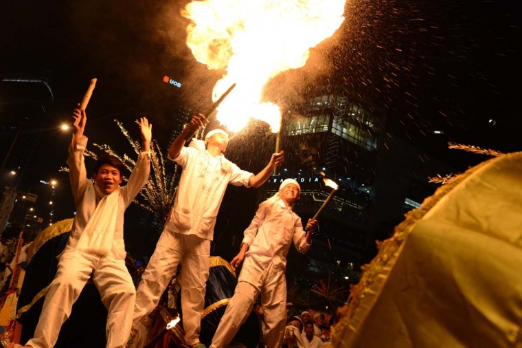 Indonesians parade with drums and torches on the eve of Eid al-Adha festivities in the capital city of Jakarta on October 14, 2013. Eid al-Adha is celebrated throughout the Muslim world in remembrance of Abraham's readiness to sacrifice his son to God with cows and goats traditionally slaughtered on this holy day. (Romeo Gacad/AFP)